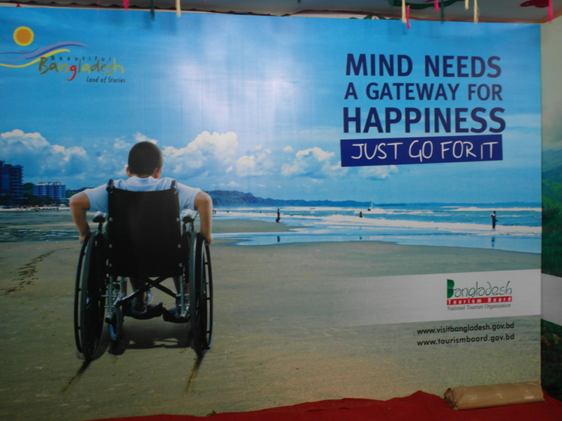 "Advertisement showing a beach, with a boy using a wheelchair in the foreground. Text reads ""Mind Needs a Gateway to Happiness: Just go for it""."