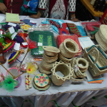 Table with woven baskets and other hand-made products.